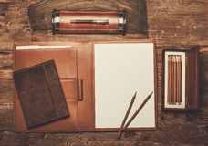 Luxurious writing tools. On a wooden table Royalty Free Stock Images