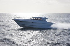 Luxurious yacht in bright backlit sunlight Stock Photo