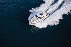 Luxurious yacht cruising through the sea Stock Photo