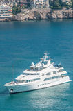 Luxurious yacht sailing on clear blue water. Stock Images