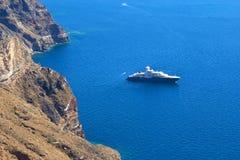 Luxurious yacht in Santorini bay in Greece Stock Image