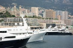 Luxurious yachts on background The Monte Carlo Casino Monaco Stock Photo