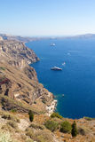 Luxurious yachts and cruise ships in Santorini bay Royalty Free Stock Images