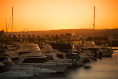 Luxurious yachts docked at the pier Royalty Free Stock Photos