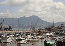 Luxurious Yachts. Hong Kong - July 2016  Luxurious yachts moored in a bay off the Victoria Harbour in Hong Kong Royalty Free Stock Photos