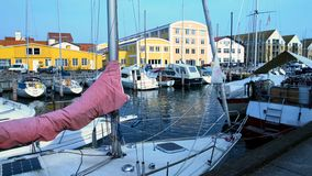 Luxurious yachts and sailboats docked in port, summer tourism, European town. Stock photo royalty free stock photo