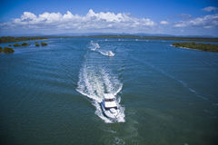 Luxurious yachts sailing in the sea Royalty Free Stock Images