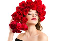 Luxurious young girl with red roses hairstyle royalty free stock photography