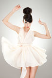 Luxurious young woman in light flying dress Royalty Free Stock Images