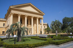 Luxurous resort design details. Beautiful villa in ancient greek classic style with landscaped green territory; outdoor panorama with copy space stock photography
