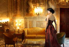 Luxury. Beautiful lady in a luxury living room Stock Photos
