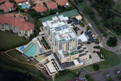 Luxury. Aerial view of luxurious resort complex and pools, tennis courts and premium residential homes and apartments royalty free stock image