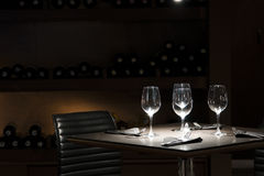 Luxury. An elegant table for four in a restaurant, with four wineglasses Royalty Free Stock Image