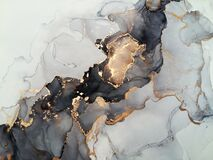 Luxury abstract fluid art painting background alcohol ink technique black shades of gray and gold. Rough edges of paint flow out