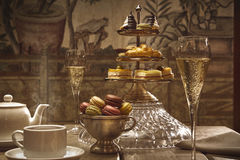 Luxury afternoon hot tea with champagne and macaroons Royalty Free Stock Images