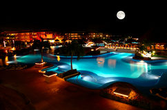 A luxury all inclusive beach resort at night royalty free stock photo