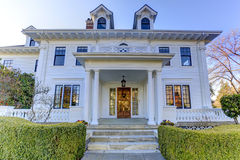Luxury american house with curb appeal. Luxury american house with column porch and curb appeal Royalty Free Stock Photos