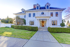 Luxury american house with curb appeal. Luxury american house with column porch and curb appeal Royalty Free Stock Photo