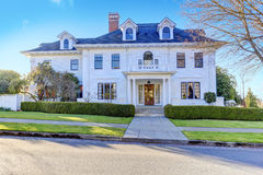 Luxury american house with curb appeal. Luxury american house with column porch and curb appeal Royalty Free Stock Image
