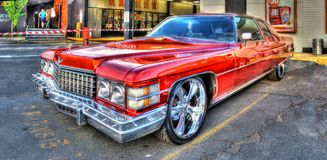 Luxury American 1970s Cadillac. 1970s luxury American built red Cadillac on display at car show in Melbourne, Australia stock image