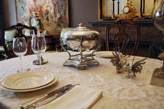 Luxury antique tablesetting. Beautifully set table with antique silverware Royalty Free Stock Photo