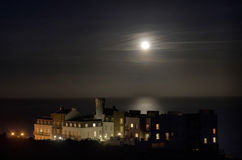 Luxury Apartment building with Full Moon Stock Image