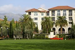 Luxury apartment building, mounting and palm trees Royalty Free Stock Photos