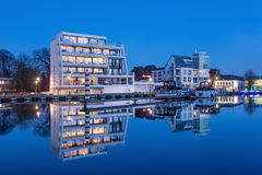 Luxury apartment building at twilight, Nieuwe Kaai, Turnhout, Belgium. TURNHOUT-APRIL 3, 2017. Luxury apartments at Nieuwe Kaai, with yacht harbor on Kempisch Stock Images