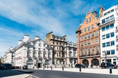 Luxury apartment buildings in Pall Mall in London. London, UK - May 14, Luxury apartment buildings in a wealthy neighborhood of London: Pall Mall and St James royalty free stock photo