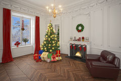 Luxury apartment decorated for christmas with christmas tree Royalty Free Stock Image