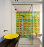 Luxury apartment, modern bathroom. With yellow sink, shower and colored tiles Royalty Free Stock Images