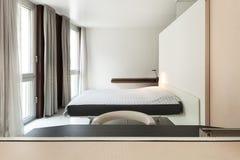 Luxury apartment, modern bedroom Stock Photos