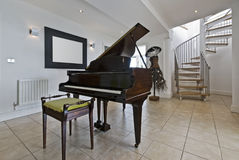 Luxury apartment with a piano. Luxury duplex penthouse apartment with a antique piano Stock Photos
