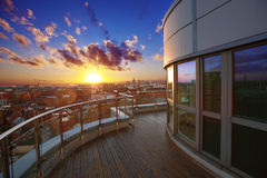 Luxury apartment terrace. City apartment with terrace and views at sunset Stock Images