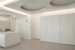 Luxury apartment, white kitchen Stock Image