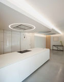 Luxury apartment, white kitchen Stock Photography