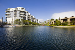 Luxury apartments beside canal Stock Photo