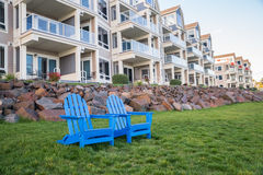 Luxury apartments. Chairs in front of a building of luxury appartments Royalty Free Stock Photography