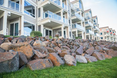 Luxury apartments. Rock piles in front of a building of luxury appartments Royalty Free Stock Images