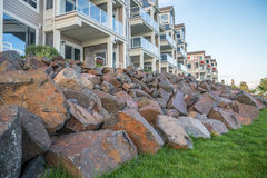 Luxury apartments. Rock piles in front of a building of luxury appartments Stock Photos