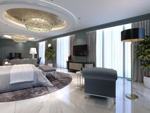 Luxury Apartments With A Bedroom And Living Area In Contemporary Style With Classic Elements, Blue Walls And Light Furniture Stock Image