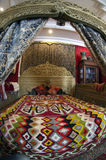 Luxury arabic bed covered with carpet in Tunisia Royalty Free Stock Images