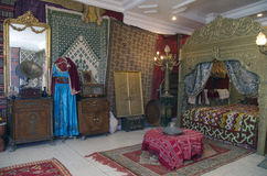 Luxury arabic interior of harem room in Tunisia. Horizontal photo of luxury arabic harem room in Tunisia in carpet store Royalty Free Stock Photo