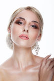 Luxury. Aristocratic Lady Blonde with Jewelry - Platinum Eardrops Royalty Free Stock Photos