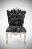 Luxury armchair. Photo of a black luxurious chair Royalty Free Stock Photo