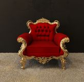 Luxury armchair with golden frames. On royal interior Royalty Free Illustration
