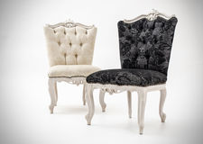 Luxury armchairs. Photo of a black and white luxurious chairs Royalty Free Stock Photos