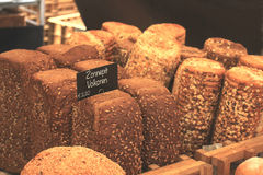 Luxury artisanal bread. At a market text on tags: product and price information in Dutch Stock Photography