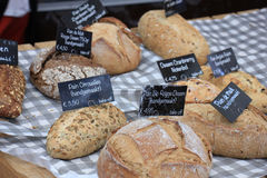 Luxury artisanal bread. At a market text on tags: product and price information in Dutch Royalty Free Stock Photography