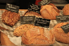 Luxury artisanal bread. At a market text on tags: product and price information in Dutch Stock Image